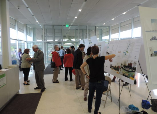 Photo of Posters and Attendees in Syracuse Center of Excellence Lobby