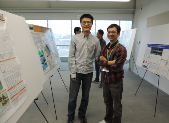Photo of Two Students with Their Posters