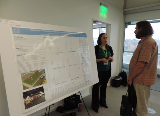 Photo of Student and Instructor Discussing Poster