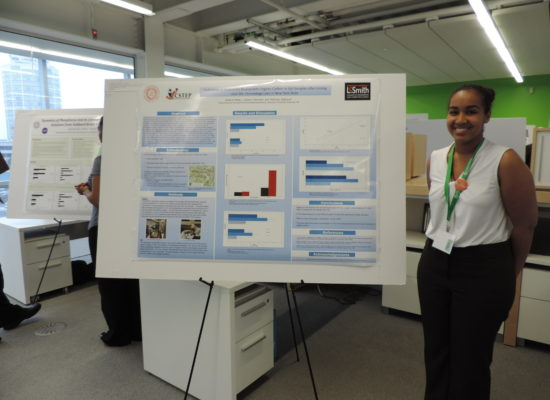Photo of Student Next to Poster