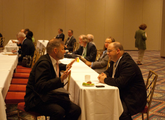 Photo of Two Conference Guests Conversing