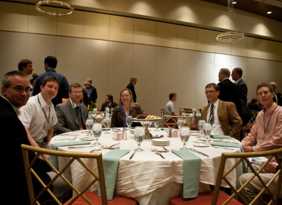 Photo of conference guests sitting at a table for lunch