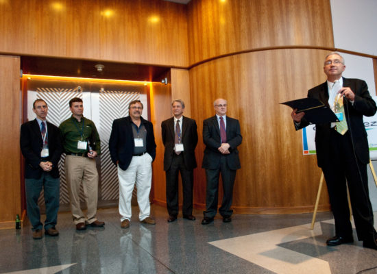Photo of Ed Bogucz and others at a presentation